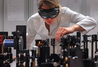 Nina Schwalb adjusting the femtosecond laser spectroscope